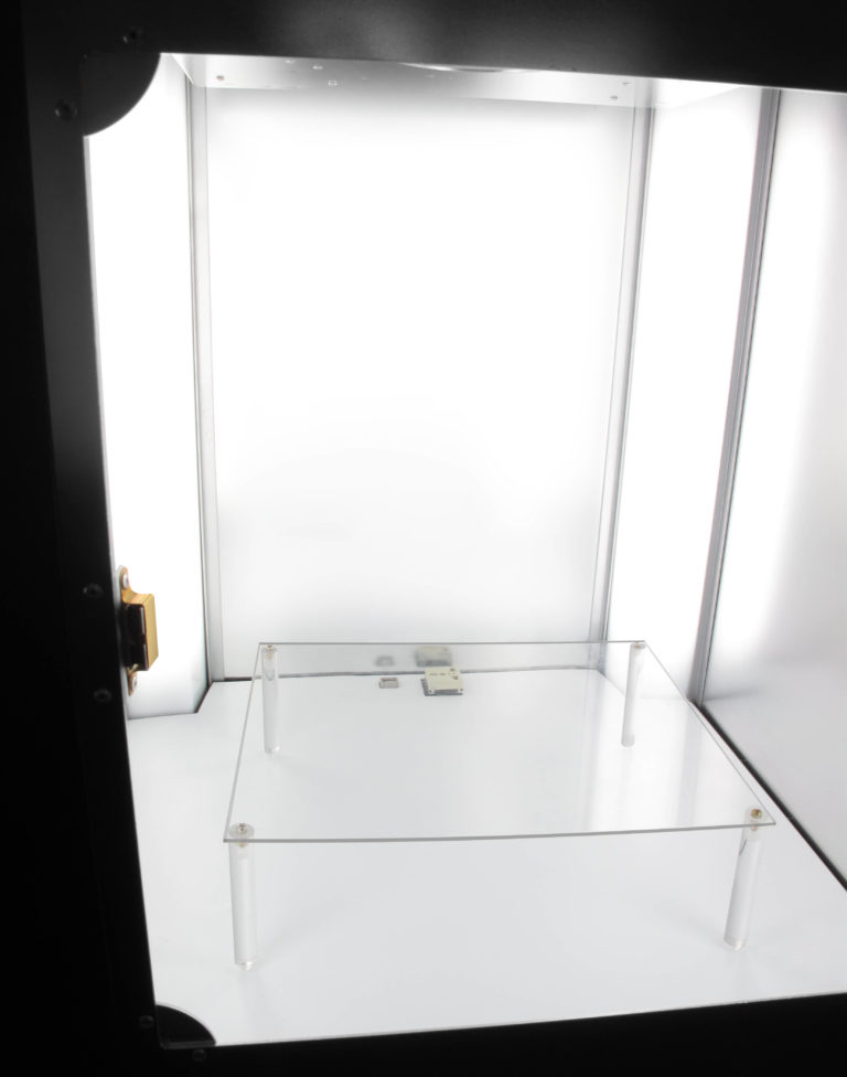 plexiglas support in an automated photo machine