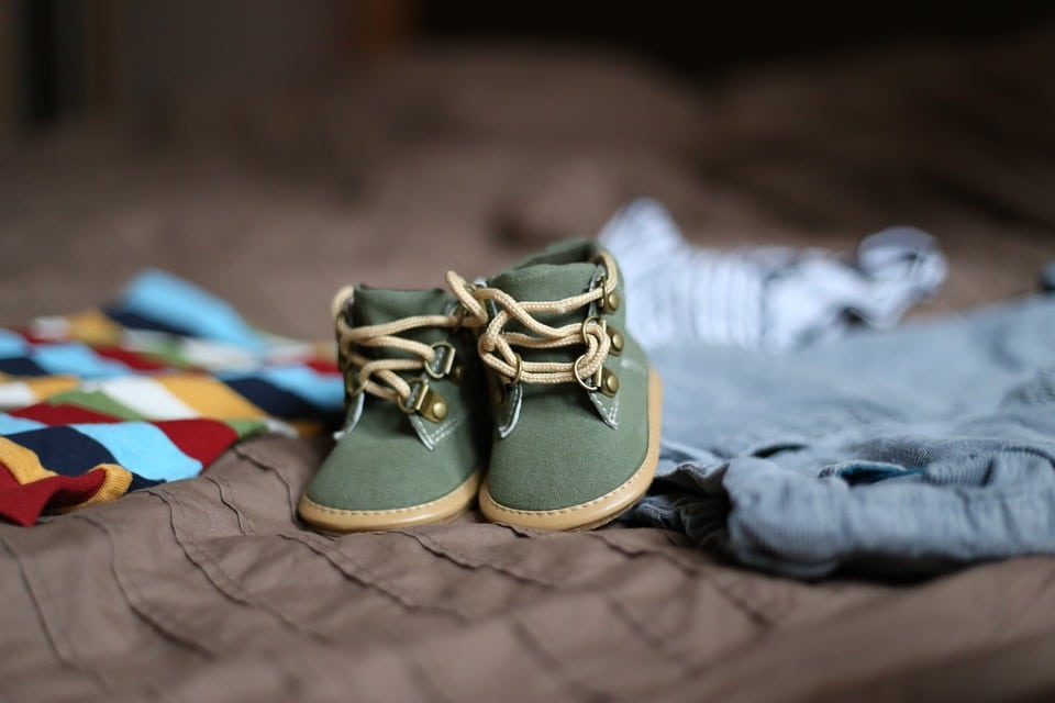 aesthetic visual of baby shoes for an online store